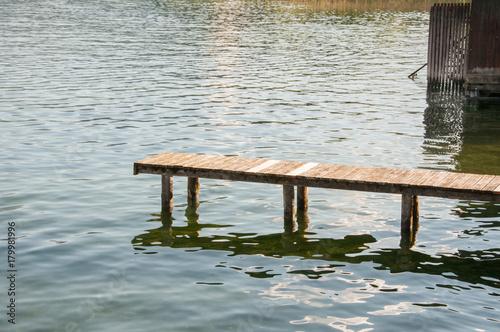 Fotobehang Pier boardwalk with calm lake