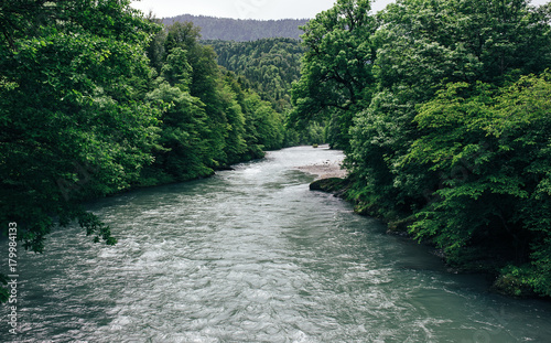 Fotobehang Bergrivier Beautiful view of mountain forest river in cloudy day.
