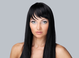 Beautiful woman face with clean fresh skin - isolated on gray