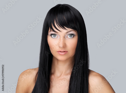 Foto op Canvas Kapsalon Beautiful woman face with clean fresh skin - isolated on gray
