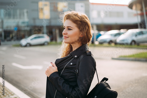 Plakat Fashion woman portrait of young pretty trendy girl posing at the city street