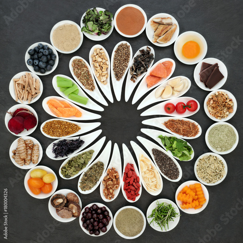 Health food with super foods concept to boost brain cognitive function on slate background. Foods high in omega 3 fatty acids, vitamins, minerals, antioxidants and anthocyanins. Top view.