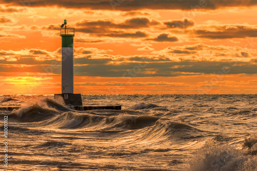 In de dag Oranje eclat Lighthouse and pier on Lake Huron under a stormy sky - Ontario, Canada