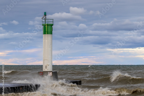 Foto op Plexiglas Natuur Lighthouse and pier on Lake Huron under a stormy sky - Ontario, Canada