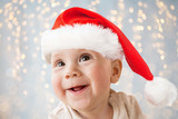 close up of happy little baby boy in santa hat - 180013385