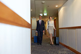 business team with travel bags at hotel corridor - 180013977