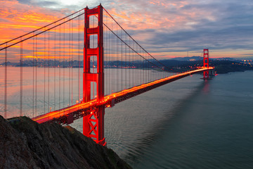 The sun rises over San Francisco and the Golden Gate Bridge