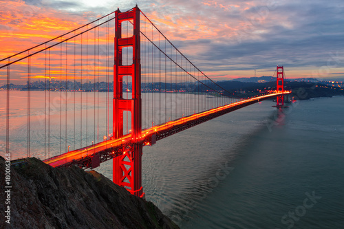 The sun rises over San Francisco and the Golden Gate Bridge Poster