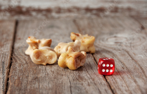 Real dice. Knuckle bones and gaming pieces. Ancient game with lamb bones .