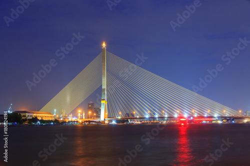 Big Suspension bridge with lighting in night time / Rama 8 bridge in night time