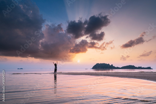Aluminium Strand Carefree woman in the sunset on the beach.