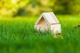Small House Made of Wood Blocks on Grass