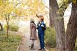 family to boys walk on autumn Woods