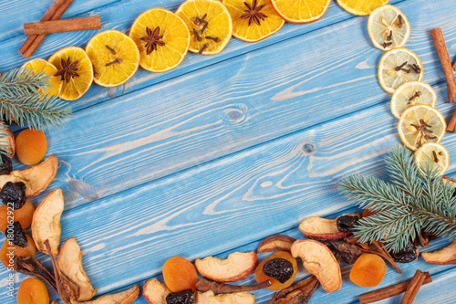 Frame of spruce branches, ingredients and spices for compote of dried fruits,