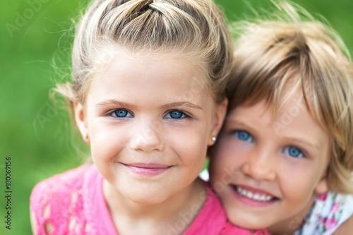Portrait of Two Little Girlfriends / Sisters Hugging