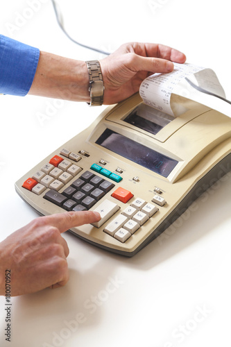 Hand presses cash register keys another takes out check - 180070952