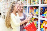 Portrait of Two Women Reading a Lable in a Supermarket - 180073104