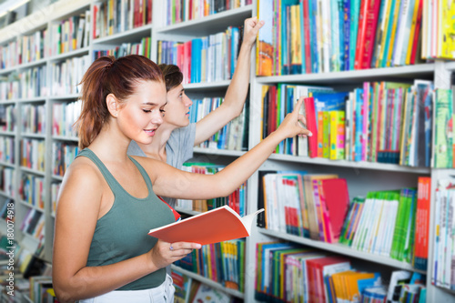 Poster Teenagers holding book and reading new literature