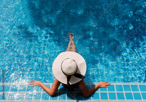 Papiers peints Spa Young asian woman relaxing in swimming pool at spa resort.relaxing concept.