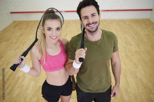 Portrait of squash players with rocket