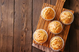 Homemade muffins with bacon and cheese on a wooden background. Healthy snack or breakfast meal. - 180087716