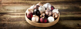 preparing a vintage Christmas with baubles on retro wood background - 180090356
