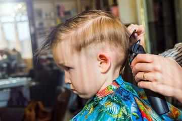 Little boy in a hairdresser