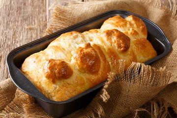Hot aromatic brioche bread in a baking dish close-up. horizontal
