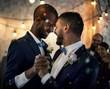 Gay couple dancing on wedding day