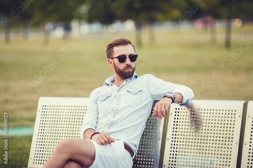 Plakat handsome man sitting on bench