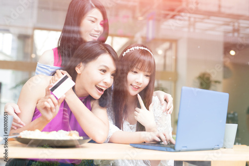 happy woman friends in restaurant - 180100551