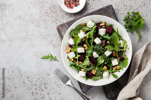 Fototapeta beetroot, arugula, feta cheese and walnut salad
