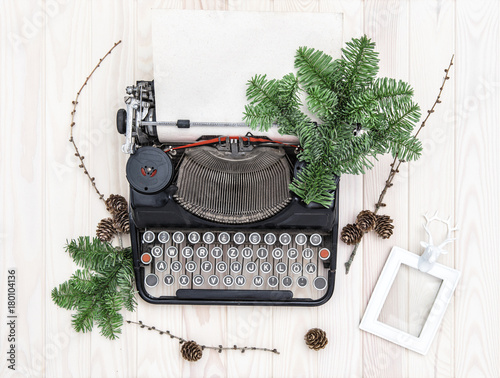Vintage typewriter christmas decoration evergreen branches