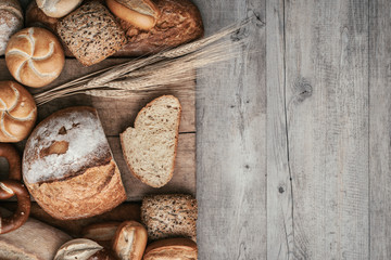Fresh bread on a wooden worktop
