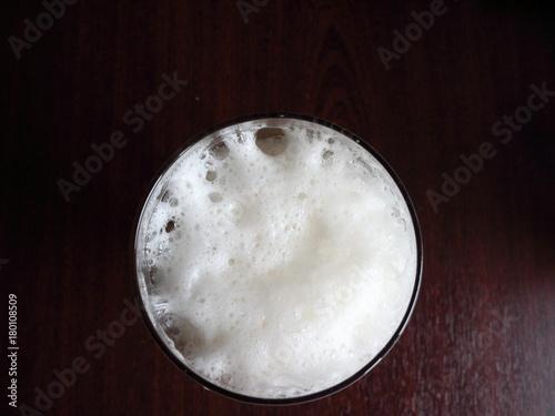 Fotobehang Heelal beer foam in a glass top view on a dark background