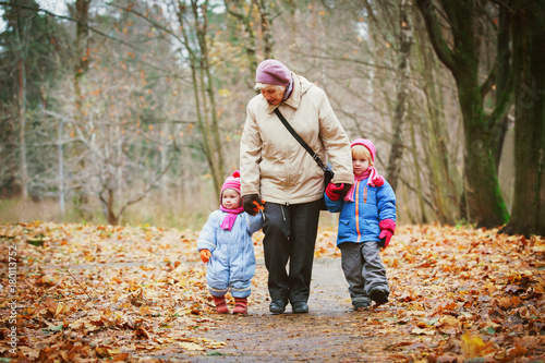 grandmother with kids walk in nature Poster