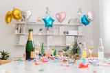 Champagne and confetti after office party in the meeting room