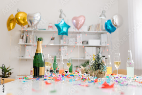 Foto Murales Champagne and confetti after office party in the meeting room