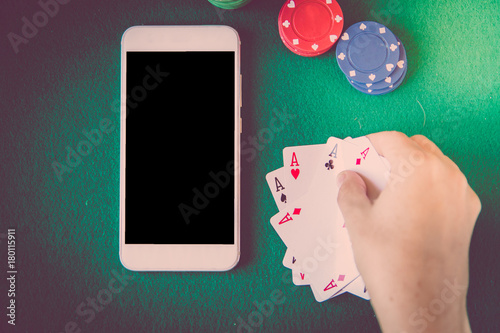 blank screen smartphone, chips and cards over poker table плакат