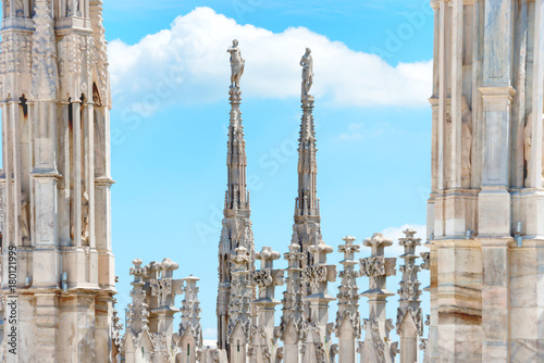 Fotobehang Milan Statues on roof of Duomo Cathedral di Milano on piazza in Milan, Italy