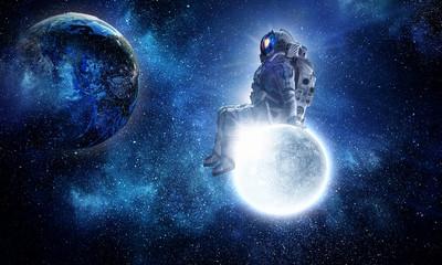 Astronaut sit on full moon. Mixed media