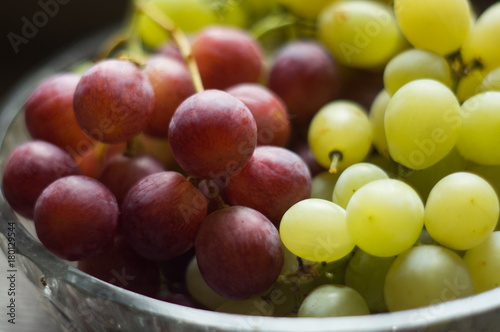 wine and colorful grapes