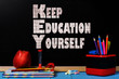 Motivation text keep education yourself on  school black chalkboard with school accessories