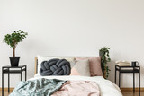Simple bright bedroom with plant - 180135198