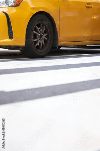 Foto op Canvas New York TAXI Abstract blur of urban street scene with a yellow taxi cab in New York