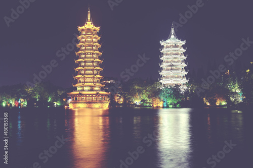 Papiers peints Aubergine Guilin Sun and Moon Tower Pagodas in Fir Lake at night, color toned picture, China