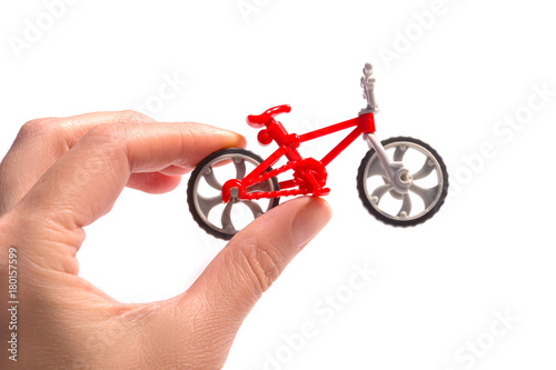 Fotobehang Fiets Small toy bicycle in woman hands