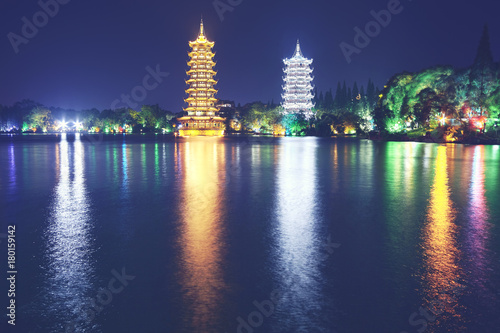 Plexiglas Guilin Guilin Sun and Moon Tower Pagodas in Fir Lake at night, color toned picture, China