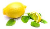 One whole yellow lemon and slice with fresh lemon balm leaves isolated on white background. - 180166740