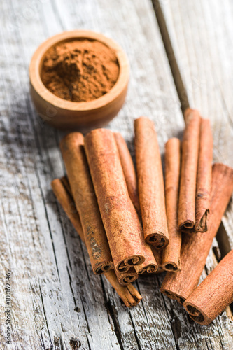 Cinnamon sticks and milled cinnamon spice.